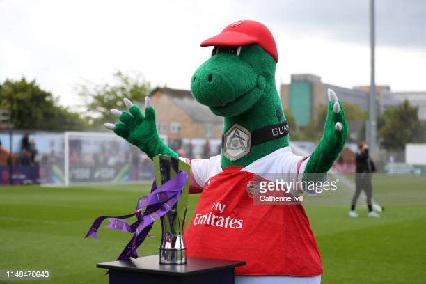 Gunnersaurus the Arsenal mascot with the Women's Super League trophy ahead of the WSL match between Arsenal Women and Manchester City at Meadow Park...