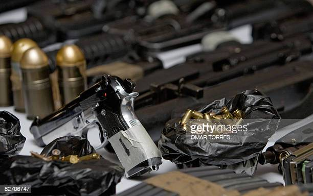 "Guns and munitions confiscated to alleged Mexican drug dealers Alberto Sanchez Hinojosa aka ""El Tony"", Francisco Arteaga Espino and Leonel Cruz..."