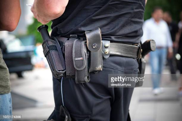 Guns and tools on the policeman's belt
