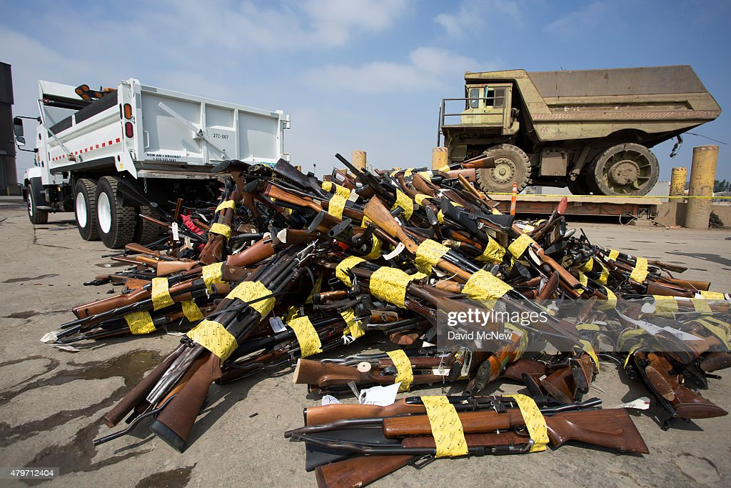 guns are heaped in a pile during the destruction of approximately 3,400 guns and other weapons at the Los Angeles County SheriffsÕ 22nd annual gun melt at Gerdau Steel Mill on July 6, 2015 in Rancho Cucamonga, California. The weapons, confiscated in various law enforcement operations, will be recycled in the form of steel rebar to be used in construction. California law requires the destruction of the confiscated weapons.