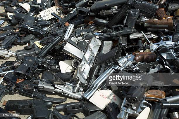 Guns are piled on the ground during the destruction of approximately 3400 guns and other weapons at the Los Angeles County SheriffsÕ 22nd annual gun...