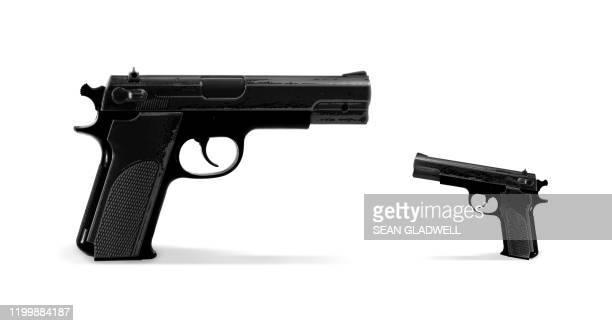 guns at standoff - gun control stock pictures, royalty-free photos & images