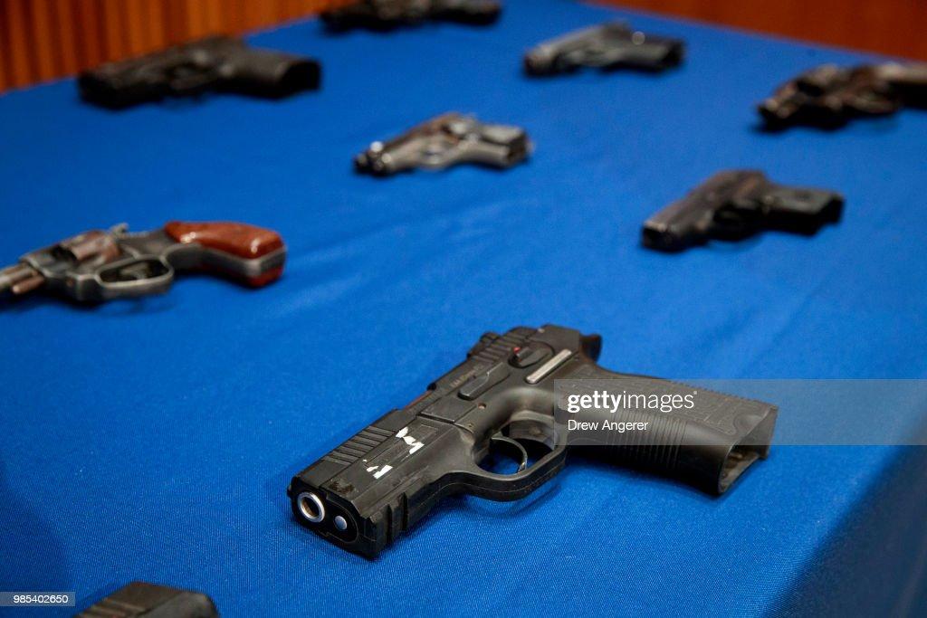 Guns belonging to members of the Mac Balla gang are displayed during