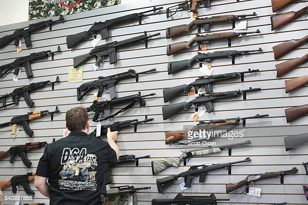 Guns built by DSA Inc and other manufacturers are displayed inside the DSA Inc. Store on June 17, 2016 in Lake Barrington, Illinois. Earlier in the...