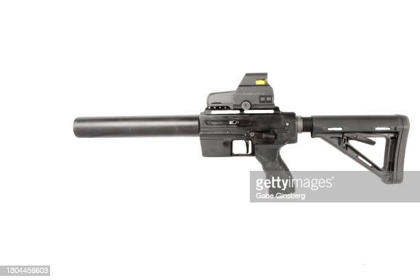 guns : close up of a .22 caliber assault rifle on white background - gun control stock pictures, royalty-free photos & images