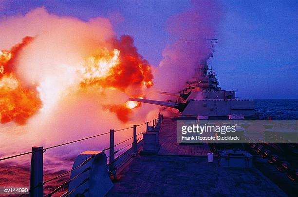 Guns firing from Battleship USS Missouri