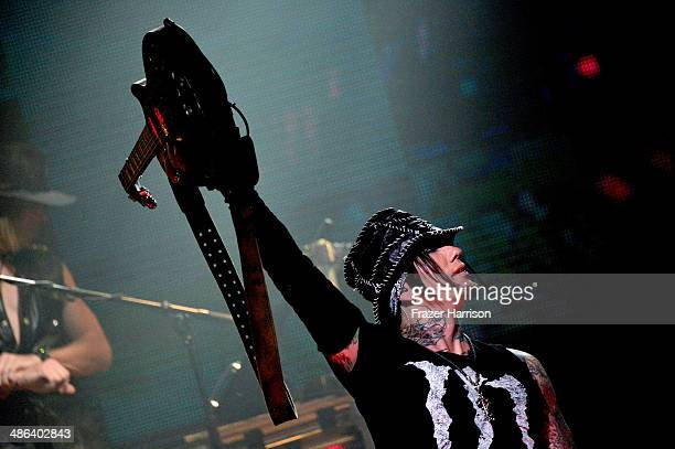 Guns N' Roes guitarist DJ Ashba perform at the 6th Annual Revolver Golden Gods Award Show at Club Nokia on April 23 2014 in Los Angeles California