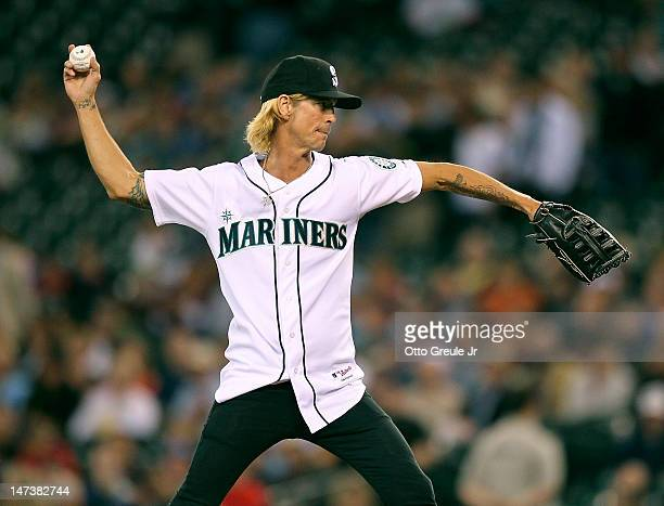 Guns N' Roses band member Duff McKagan throws out the ceremonial first pitch prior to the game between the Seattle Mariners and the Boston Red Sox at...