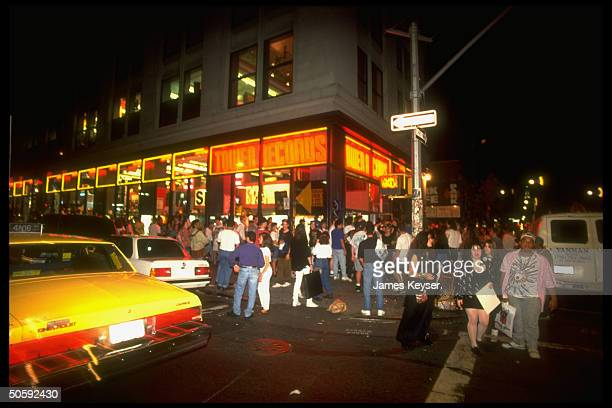 Guns N' Roses fans waiting outside Tower Records at midnight hot to buy justreleased new albums Use Your Illusion I Use Your Illusion II