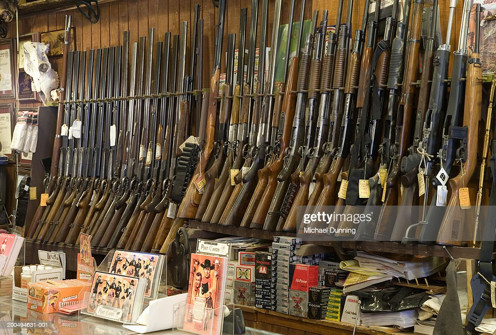 Guns on rack in store, close-up : Stock Photo