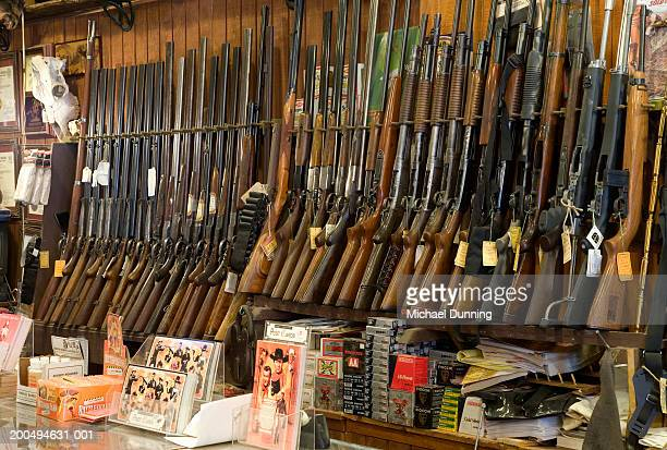guns on rack in store, close-up - gun stock pictures, royalty-free photos & images