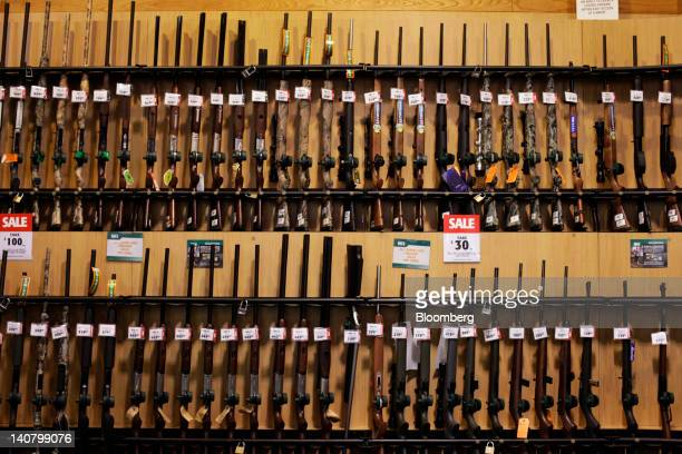 Guns sit on display at a Dick's Sporting Goods Inc store in Paramus New Jersey US on Tuesday March 6 2012 Dick's Sporting Goods which had 480 stores...