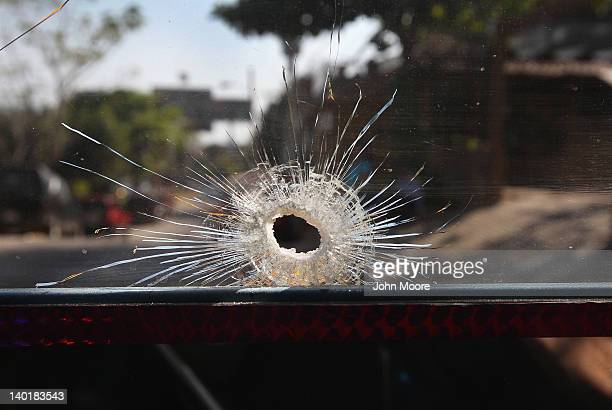 A gunshot hole pierces the windshield of a bus where a driver died in an apparent drugrelated execution on February 29 2012 in Acapulco Mexico Drug...
