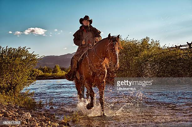 Gunslinger On Horseback Riding In The Riverbed