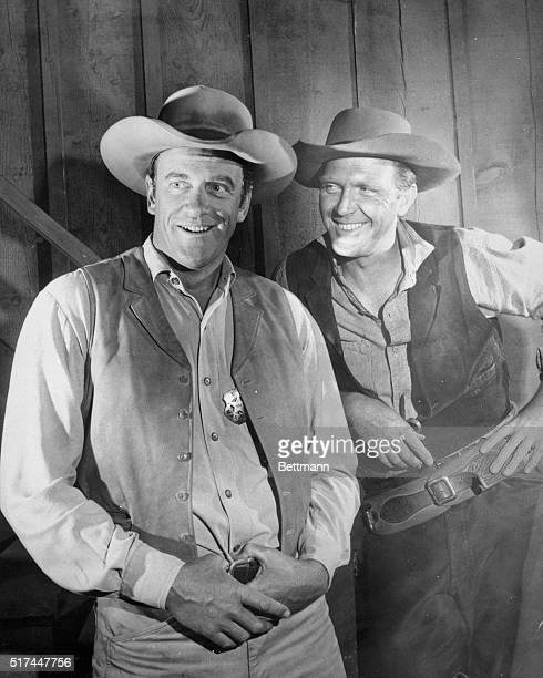 Gunsmoke CBS TV series that ran from 1955 to 1975 James Arness as Marshal Matt Dillon standing to the left and Robert Lansing as an unidentified...