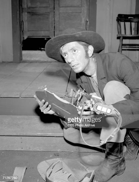 'Gunsmoke' episode The Guitar featuring Aaron Spelling with a broken guitar Image dated May 11 1956