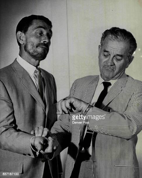 AUG 27 1964 'Gunsmoke' Stars Milburn Stone right Doc in the Gunsmoke series for the past ten seasons reverts to type by checking the pulse of Ken...