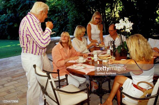 Gunter Sachs and his family with wife Mirja and his sons Christian Gunnar and Claus Alexander at the table in Sankt Tropez France 2004