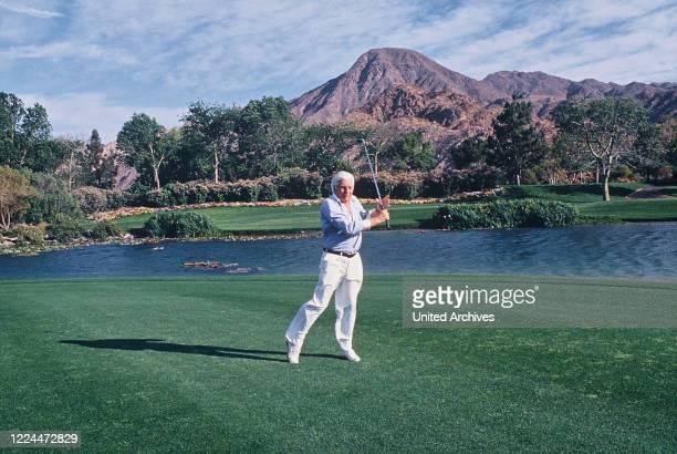 Gunter Sachs relaxing by playing a golf match, 2000s.