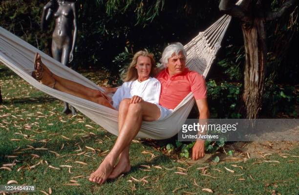 Gunter Sachs relaxing in a hammock with his wife Mirja