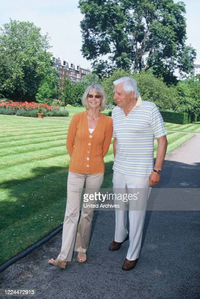 Gunter Sachs with his wife Mirja on a walk in a park or in their own garden 2000s