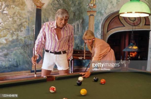 Gunter Sachs with his wife Mirja playing billards.