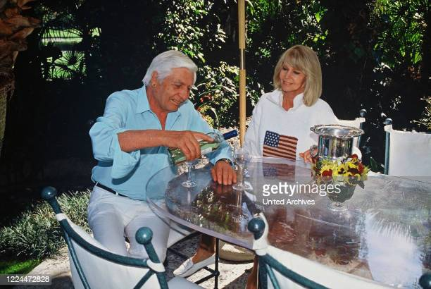 Gunter Sachs with wife Mirja having a glass of wine in the garden 2000s