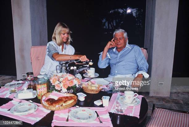 Gunter Sachs with wife Mirja having coffee and cake on a terrace, 2000s.