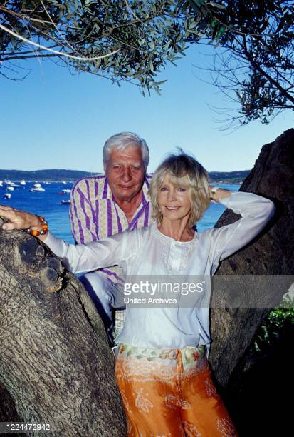 Gunter Sachs with wife Mirja posing between trees at their estate in Sankt Tropez France 2004