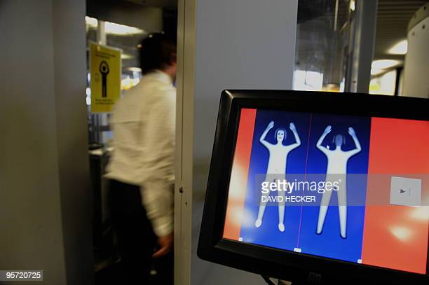 Gunter van Adrichem project manager Security Scanner at Amsterdam's Schiphol airport demonstrates the use of a body scanner on January 12 2010...