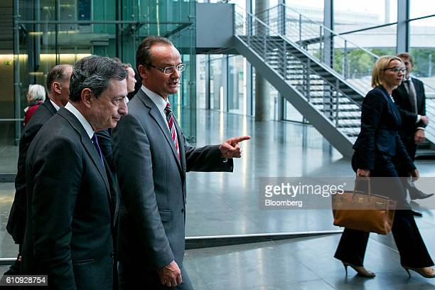 Gunther Krichbaum chairman of the European Affairs Committee center and Mario Draghi president of the European Central Bank left leave after a news...