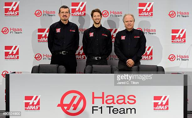 Gunther Steiner team principal of Haas F1 Team Romain Grosjean of France and Gene Haas owner of Haas F1 Team pose for a photo opportunity after Haas...