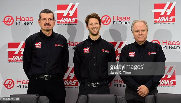 Gunther Steiner, team principal of Haas F1 Team, Romain Grosjean of France, and Gene Haas, owner of Haas F1 Team, pose for a photo opportunity after...