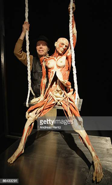 Gunther von Hagens poses next to a plastinated human body exhibit at the 'Body Worlds' the anatomical exhibition of real human bodies by German...