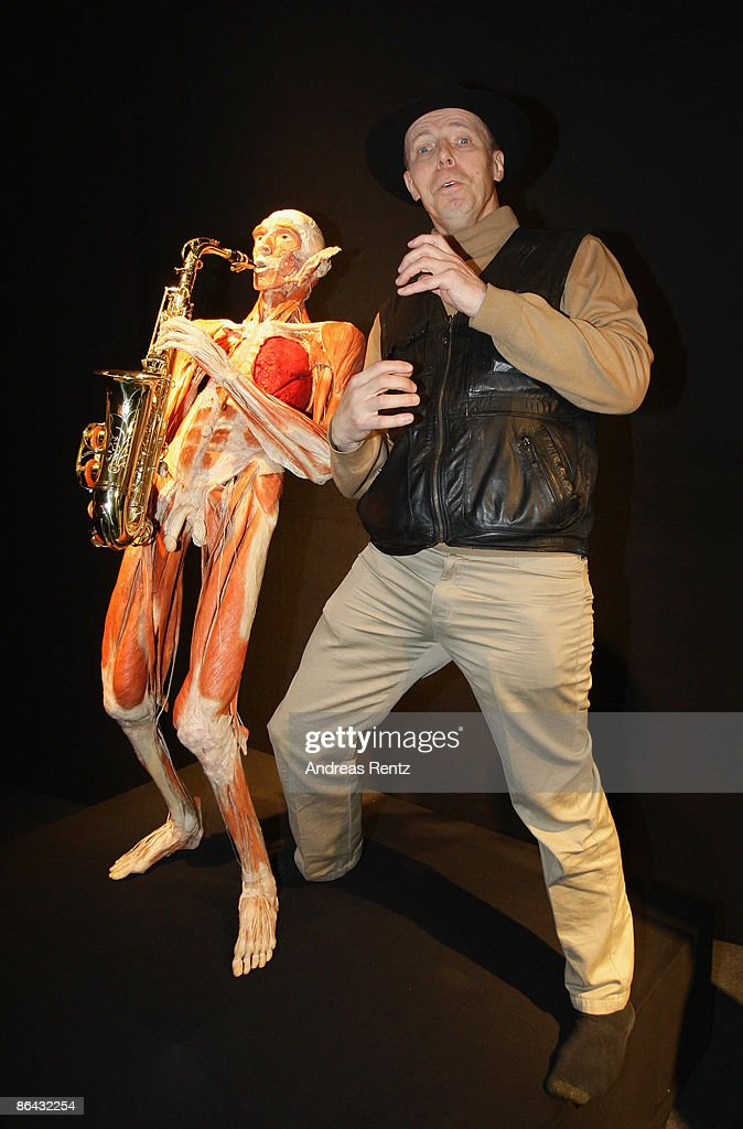 Gunther Von Hagens Poses With A Saxophone Musician Exhibit At His News Photo Getty Images