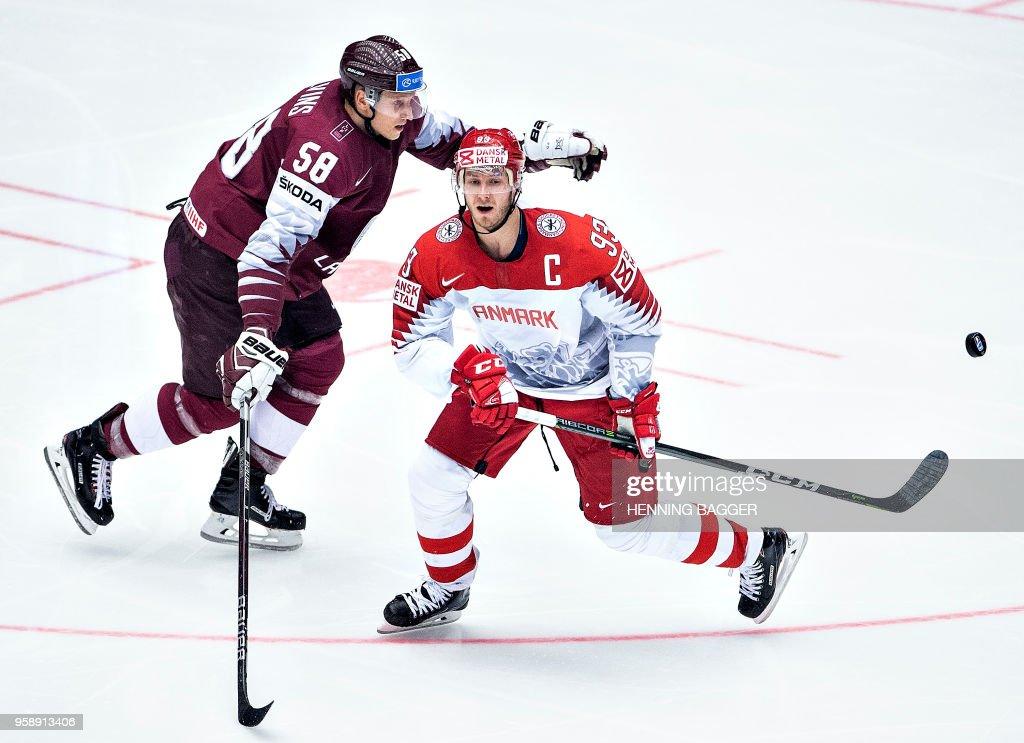 Guntis Galvins of Latvia blocks Peter Regin of Denmark during the group B match Latvia v Denmark of the 2018 IIHF Ice Hockey World Championship at the Jyske Bank Boxen in Herning, Denmark, on May 15, 2018. (Photo by Henning Bagger / Ritzau Scanpix / AFP) / Denmark OUT