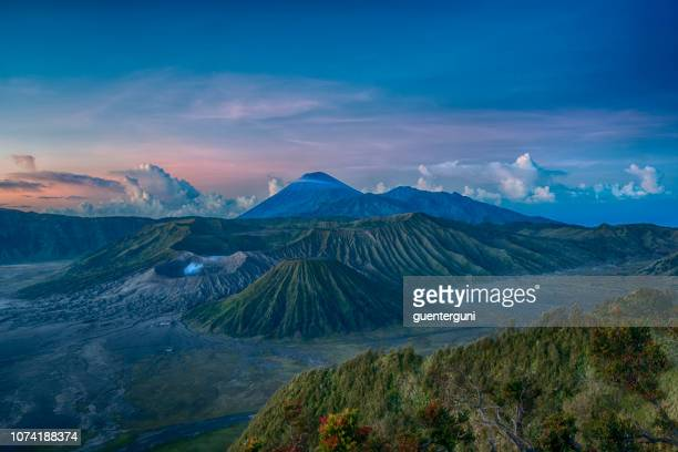 gunung bromo and semeru volcano before sunrise, java, indonesia - java stock pictures, royalty-free photos & images