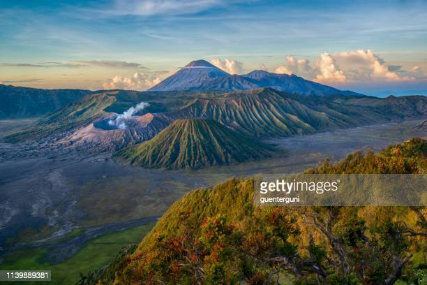 gunung bromo and semeru volcano before sunrise, java, indonesia - tengger stock pictures, royalty-free photos & images