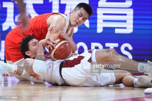 Guo Ailun of China and Michael Carrera of Venezuela fight for the ball during FIBA World Cup 2019 Group A match between Venezuela and China at...