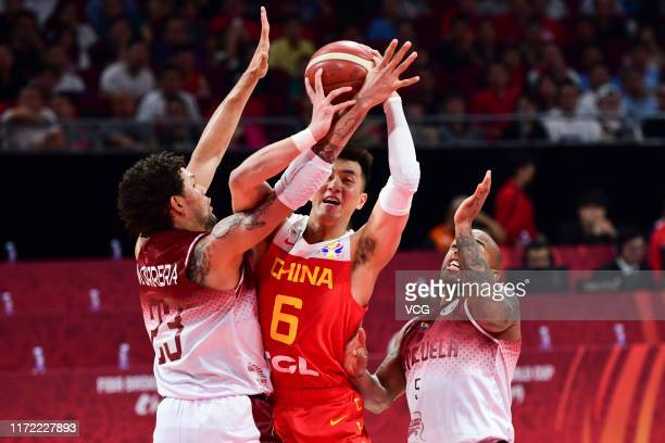 Guo Ailun of China drives the ball against Michael Carrera of Venezuela during FIBA World Cup 2019 Group A match between Venezuela and China at...