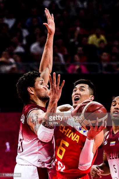 Guo Ailun of China shoots against Michael Carrera of Venezuela during the 3rd round Group A march between China and Venezuela of 2019 FIBA World Cup...