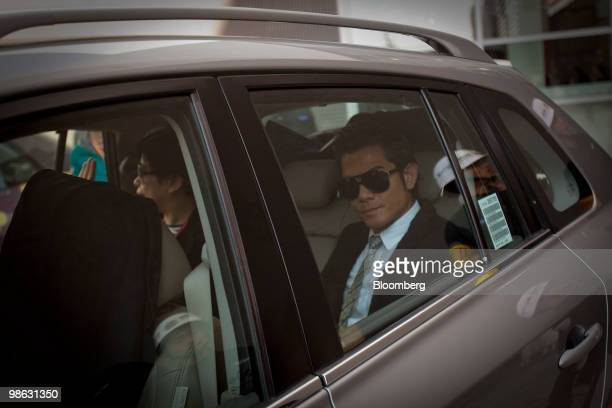 Guo Fu Cheng a Hong Kong entertainer leaves the Beijing Auto Show in Beijing China on Friday April 23 2010 The Beijing Auto Show runs until April 27...