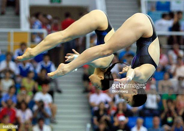 Guo Jingjing left and Wu Minxia of China compete in the women's synchronized 3meter springboard diving event on day two of the 2008 Beijing Olympics...