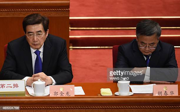 Guo Jinlong a member of the Political Bureau of the 18th Communist Party of China Central Committee and Guangdong provincial Party chief Hu Chunhua...