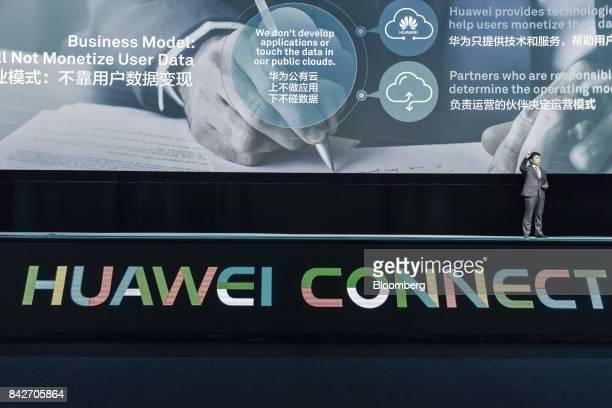 Guo Ping rotating chief executive officer and deputy chairman of Huawei Technologies Co speaks during a keynote address at the Huawei Connect 2017...
