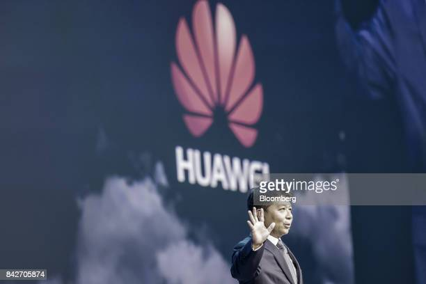 Guo Ping rotating chief executive officer and deputy chairman of Huawei Technologies Co gestures while speaking during a keynote address at the...