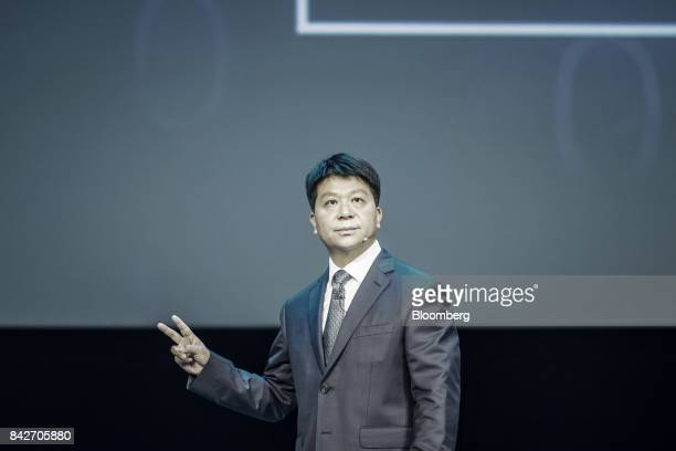 Guo Ping rotating chief executive officer and deputy chairman of Huawei Technologies Co gestures during a keynote address at the Huawei Connect 2017...