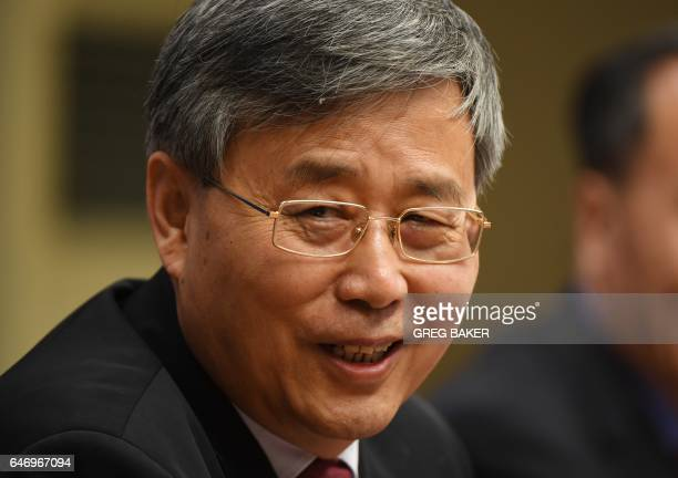 Guo Shuqing Chairman of the China Banking Regulatory Commission attends a press conference in Beijing on March 2 2017 / AFP PHOTO / GREG BAKER