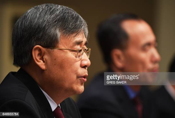 Guo Shuqing Chairman of the China Banking Regulatory Commission speaks at a press conference in Beijing on March 2 2017 / AFP PHOTO / GREG BAKER
