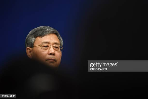 Guo Shuqing Chairman of the China Banking Regulatory Commission listens to a question during a press conference in Beijing on March 2 2017 / AFP...